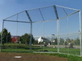 Baseball batters fence backstop